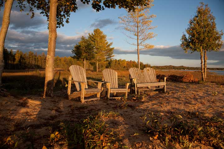Adirondack wooden chairs at sunset in downtown Harbor Springs in northern Michigan
