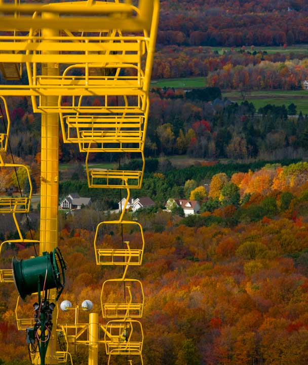 Beautiful fall colors at chairlift at Nub's Nob ski area in Harbor Springs northern Michigan