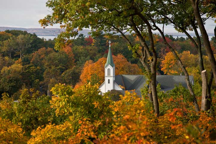 Autumn fall colors in downtown Harbor Springs church steeple northern Michigan