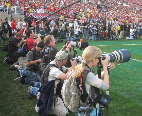 Professional photographers in the end zone shooting the Rose Bowl game