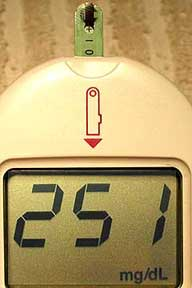 The blood glucose machine showing a reading of 251
