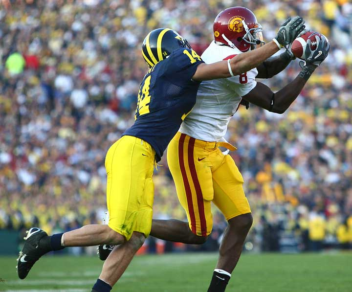 University of Michigan safety trying to stop USC receiver from catching the ball at the Rose Bowl