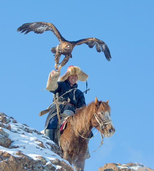 Kazakh nomad with his golden eagle hunting for fox