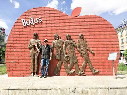 Dr. P in front of statues of the four Beatles in Ulan Bataar Mongolia