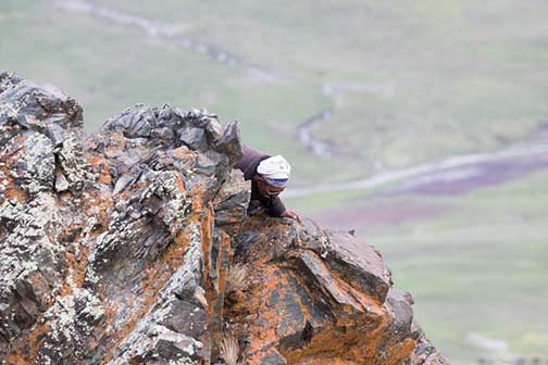 Our nomad guide climbing to get a better view of the nest