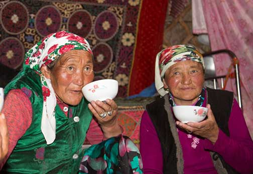 Nomad ladies drinking milk and tea prior to the mutton feast