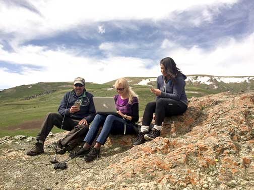 Dr. P and his 2 travel companions trying to get WiFi on top of a mountain in western Mongolia