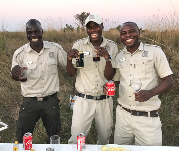 Moremi guides serving drinks