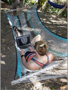 Veterinarian Reading A Radiograph While In a Hammock