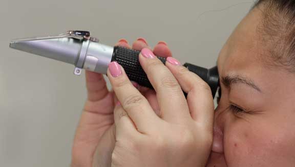 Nurse reading the refractometer