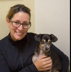Owner holding dog that has Addison's
