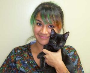 Nurse holding cat
