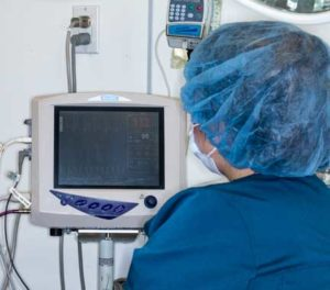 Nurse anesthetist watching anesthetic monitor