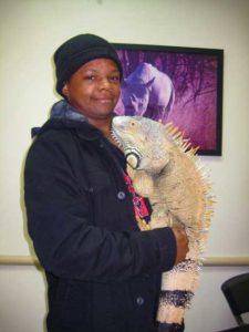 Owner holding a large male iguana