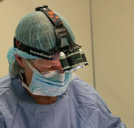 Surgeon with magnifying light